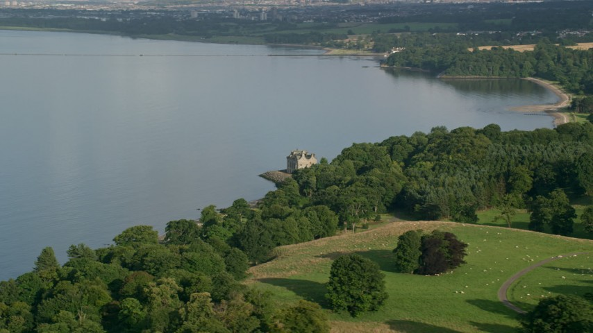 6K stock footage aerial video of historic Barnbougle Castle beside the Firth of Forth, Edinburgh, Scotland Aerial Stock Footage   AX111_085