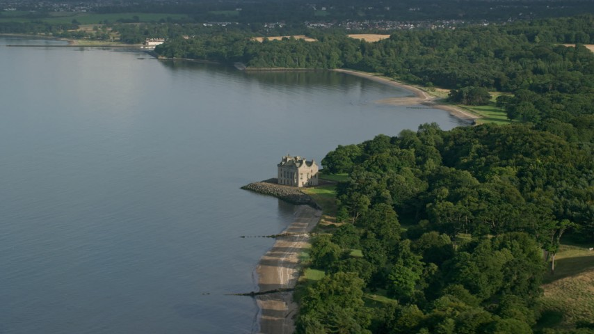 6K stock footage aerial video of iconic Barnbougle Castle beside Firth of Forth in Edinburgh, Scotland Aerial Stock Footage AX111_086 | Axiom Images