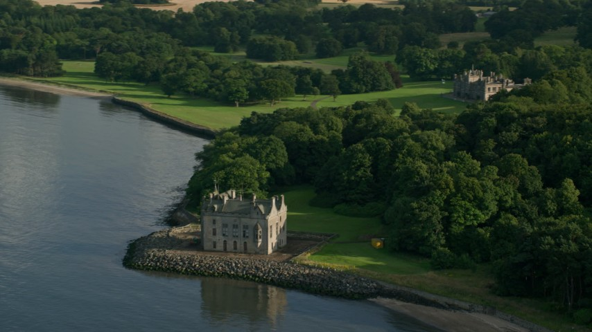 6K stock footage aerial video of historic Barnbougle Castle and Dalmeny House by Firth of Forth, Edinburgh, Scotland Aerial Stock Footage | AX111_088