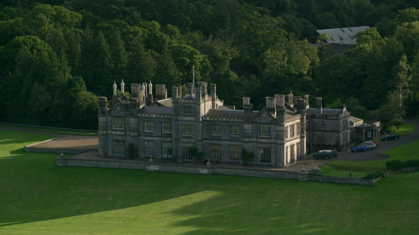 6K stock footage aerial video of Dalmeny House beside trees, Edinburgh, Scotland Aerial Stock Footage | AX111_090