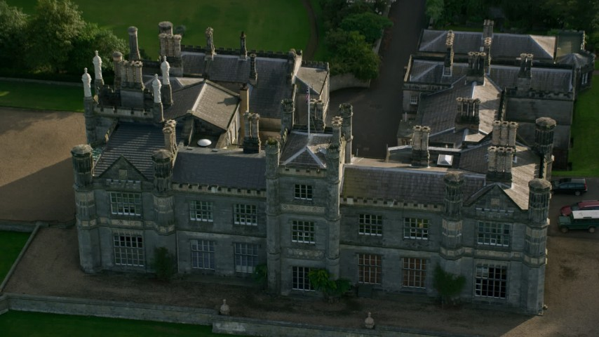 6K stock footage aerial video fly over Dalmeny House and tilt to courtyard, Edinburgh, Scotland Aerial Stock Footage | AX111_091