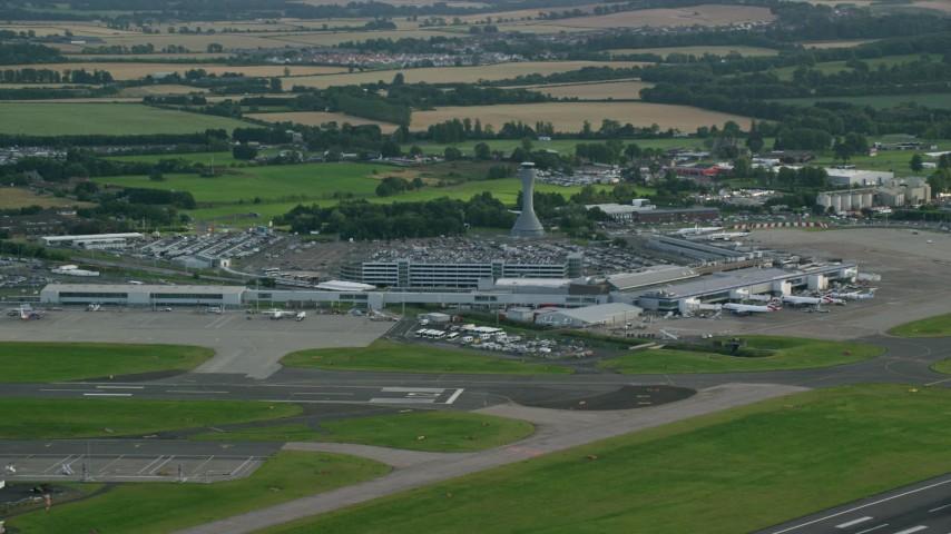 6K stock footage aerial video of Edinburgh Airport and farmland, Scotland Aerial Stock Footage | AX111_105