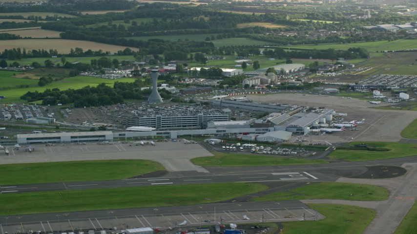 6K stock footage aerial video of the Edinburgh Airport and farmland, Scotland Aerial Stock Footage | AX111_106