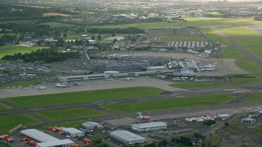 6K stock footage aerial video of Edinburgh Airport runways and terminals, Scotland Aerial Stock Footage | AX111_107