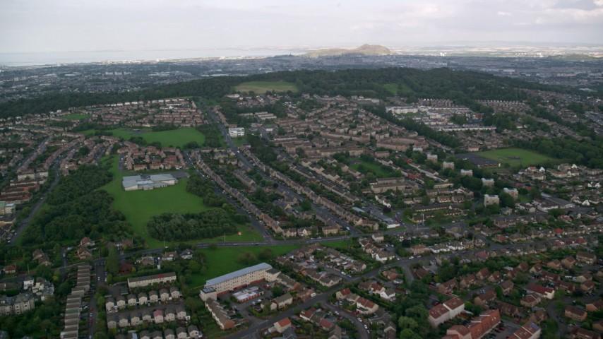 6K stock footage aerial video of suburban neighborhoods in Edinburgh, Scotland Aerial Stock Footage | AX111_109