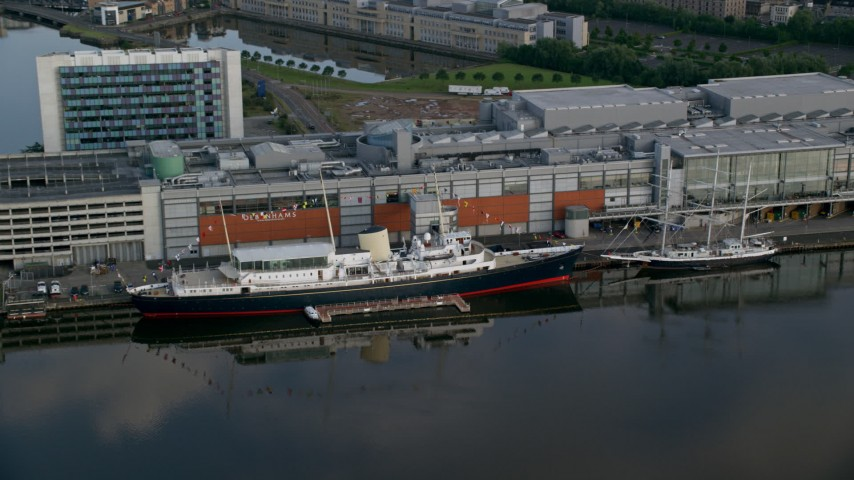 6K stock footage aerial video of the HMY Britannia at Port of Edinburgh, Scotland Aerial Stock Footage AX111_121 | Axiom Images