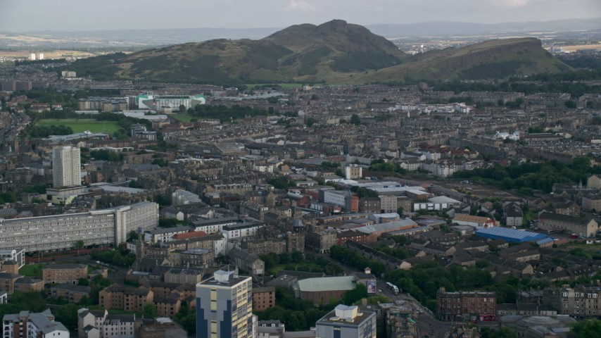 6K stock footage aerial video approach Arthur's Seat peak from the city, Edinburgh, Scotland Aerial Stock Footage | AX111_123
