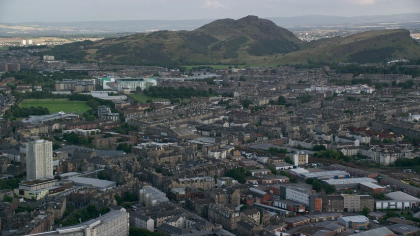 6K stock footage aerial video approach Easter Road soccer stadium and Arthur's Seat peak, Edinburgh, Scotland Aerial Stock Footage | AX111_124