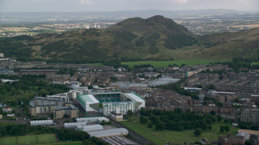 6K stock footage aerial video of Easter Road soccer stadium and Arthur's Seat mountain, Edinburgh, Scotland Aerial Stock Footage | AX111_126