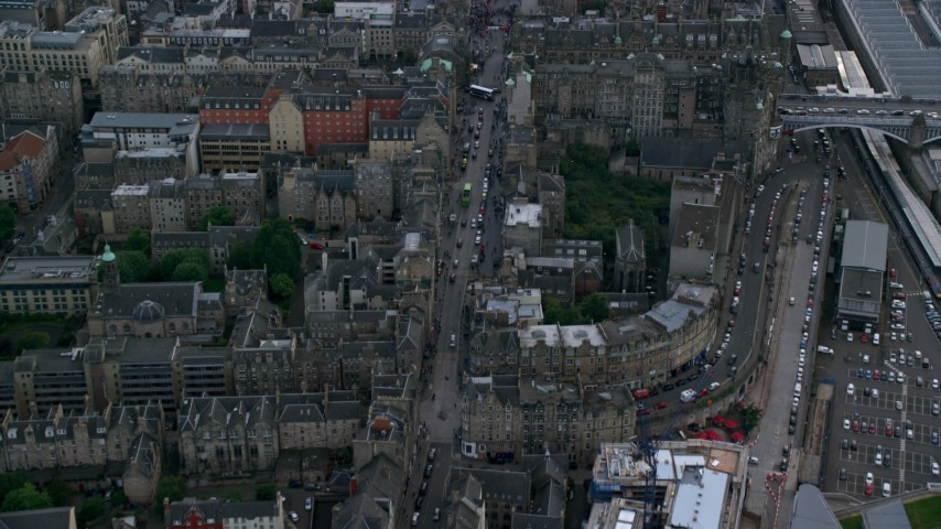 6K stock footage aerial video of Canongate buildings and street, reveal crowd, Edinburgh, Scotland Aerial Stock Footage | AX111_132