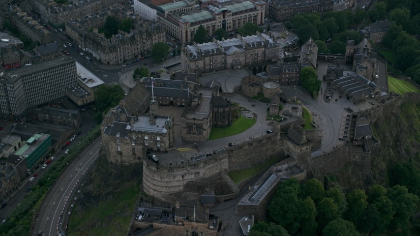 6K stock footage aerial video fly over Edinburgh Castle and tilt to courtyard, Scotland Aerial Stock Footage | AX111_136
