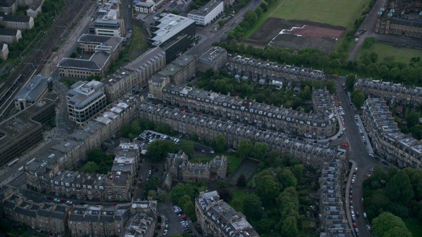 6K stock footage aerial video approach row houses in Edinburgh, Scotland Aerial Stock Footage | AX111_138