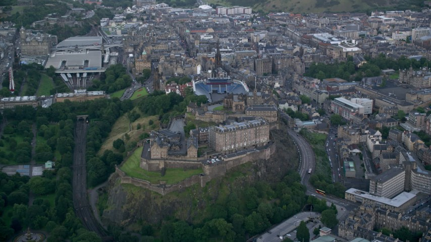 6K stock footage aerial video approach Edinburgh Castle in Scotland Aerial Stock Footage | AX111_139