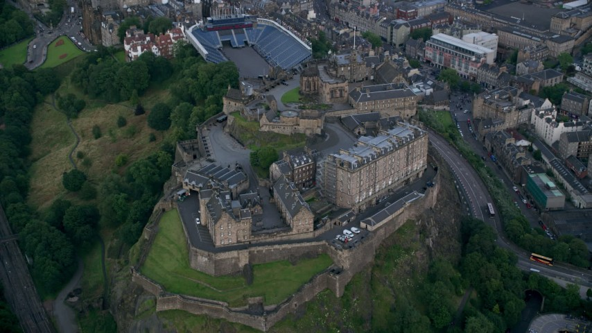 6K stock footage aerial video of historic Edinburgh Castle, Scotland Aerial Stock Footage | AX111_140