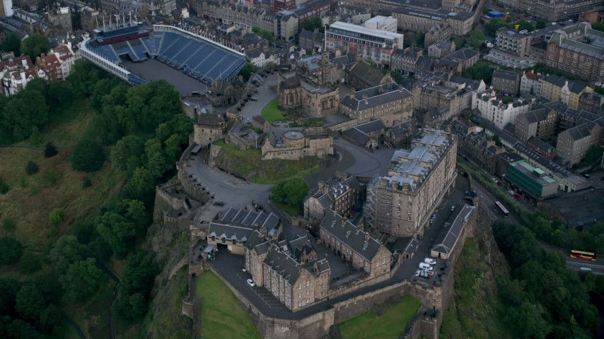 6K stock footage aerial video of flying by iconic Edinburgh Castle, Scotland Aerial Stock Footage | AX111_141