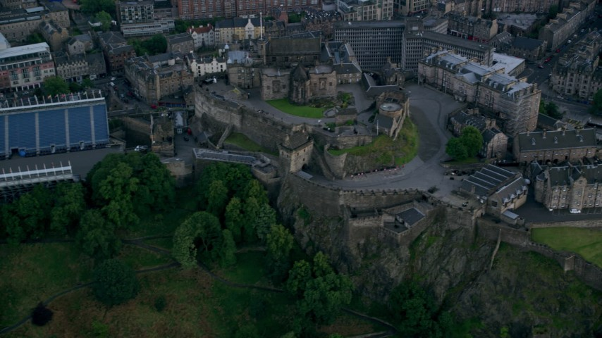 6K stock footage aerial video of passing historic Edinburgh Castle, Scotland Aerial Stock Footage | AX111_143