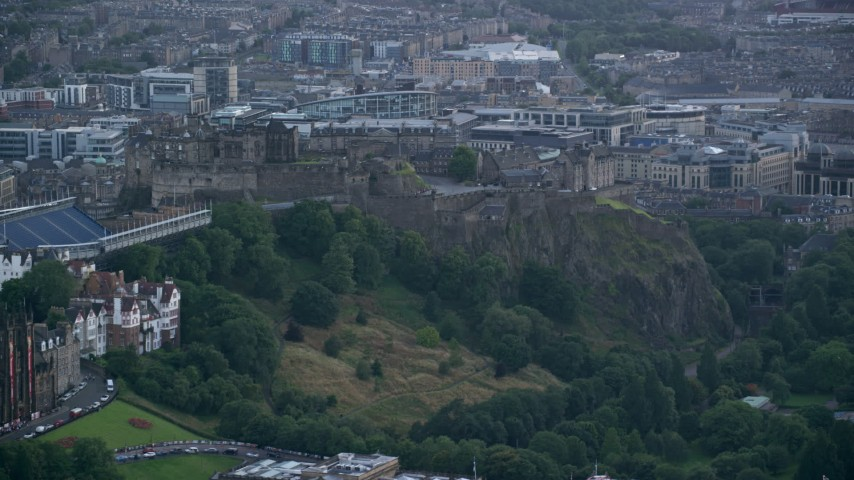 6K stock footage aerial video of historic Edinburgh Castle atop a flat hill in Scotland Aerial Stock Footage | AX111_149