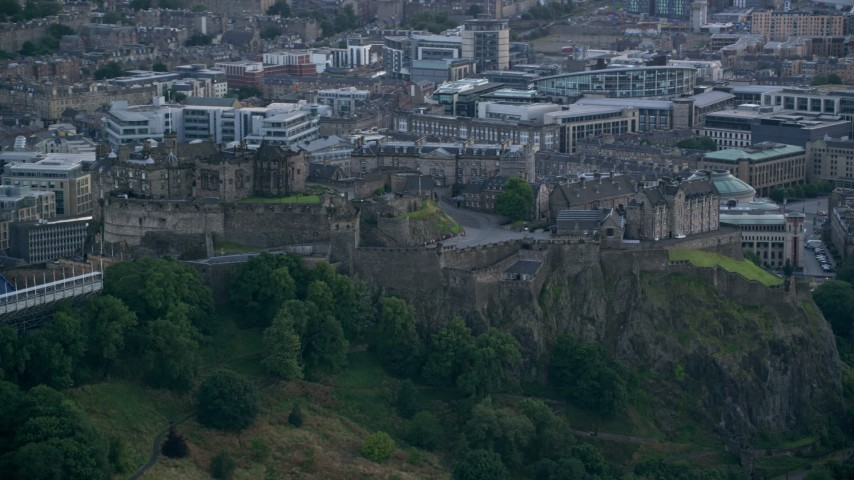 6K stock footage aerial video of iconic Edinburgh Castle, Scotland Aerial Stock Footage | AX111_150
