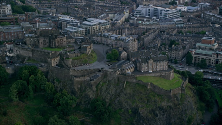 6K stock footage aerial video of orbiting historic Edinburgh Castle on a hilltop, Scotland Aerial Stock Footage | AX111_151