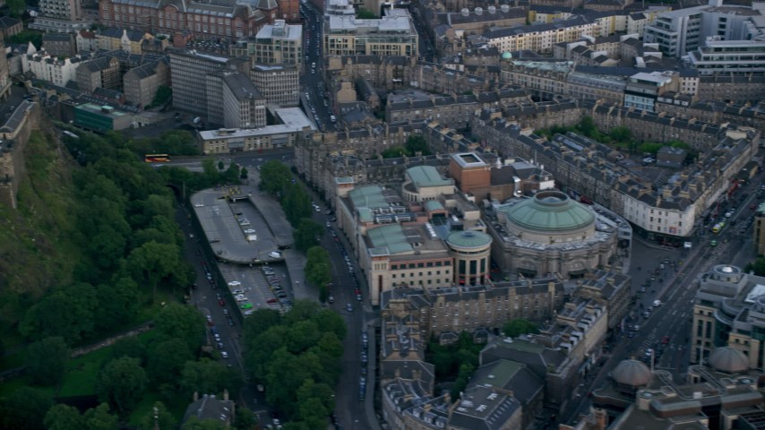 6K stock footage aerial video flyby Edinburgh Castle revealing Usher Hall and Traverse Theater, Scotland Aerial Stock Footage | AX111_152