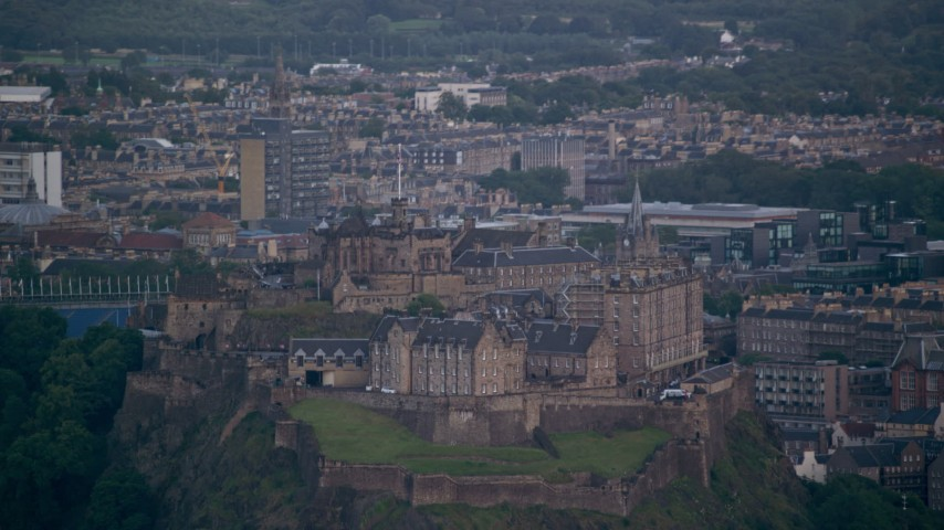 6K stock footage aerial video of the historic Edinburgh Castle and cityscape, Scotland Aerial Stock Footage | AX111_155