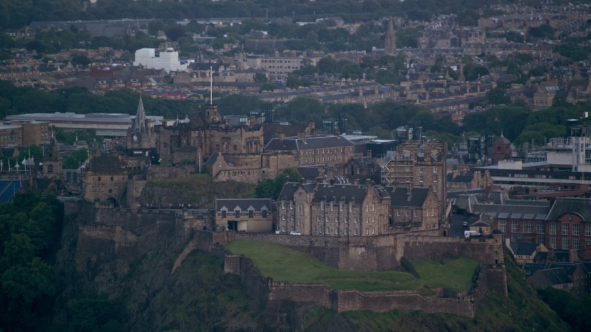 6K stock footage aerial video of Edinburgh Castle with a view of the cityscape, Scotland Aerial Stock Footage | AX111_156