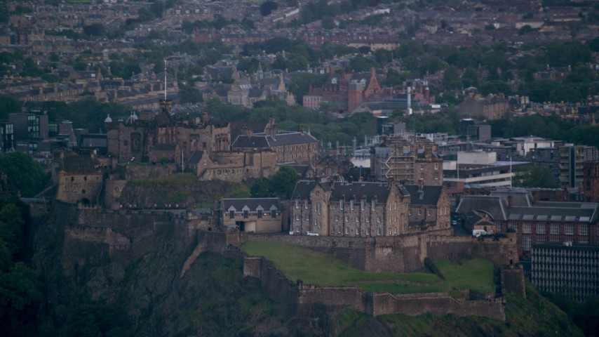 6K stock footage aerial video of flying by Edinburgh Castle and cityscape, Scotland Aerial Stock Footage | AX111_157