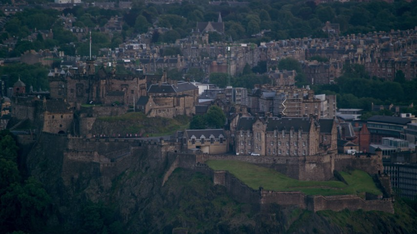 6K stock footage aerial video of passing by Edinburgh Castle and the cityscape, Scotland Aerial Stock Footage | AX111_158