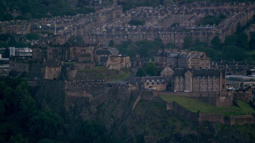6K stock footage aerial video of Edinburgh Castle with a view of the cityscape, Scotland Aerial Stock Footage | AX111_159