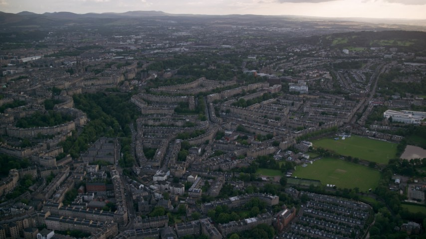 6K stock footage aerial video approach and fly over row houses in Edinburgh, Scotland Aerial Stock Footage | AX111_162