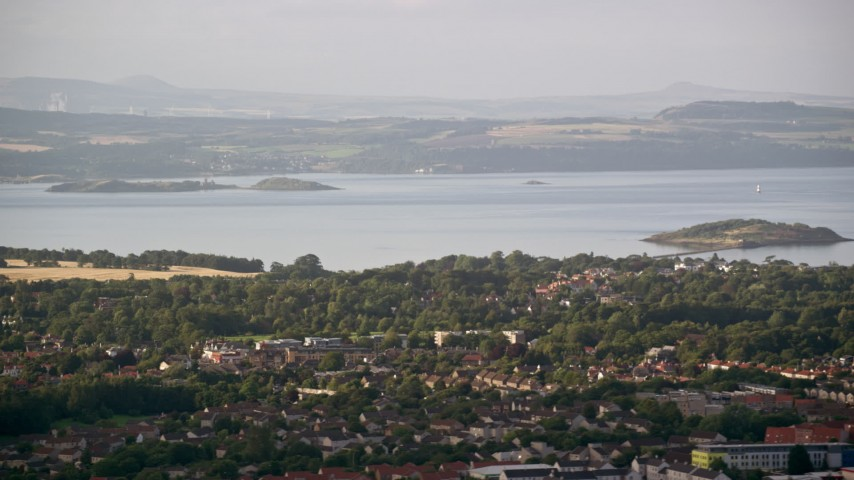 6K stock footage aerial video of suburban neighborhood near Firth of Forth, Edinburgh, Scotland Aerial Stock Footage | AX111_167