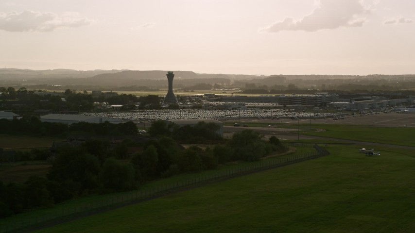 6K stock footage aerial video of Edinburgh Airport and control tower, Scotland Aerial Stock Footage | AX111_169