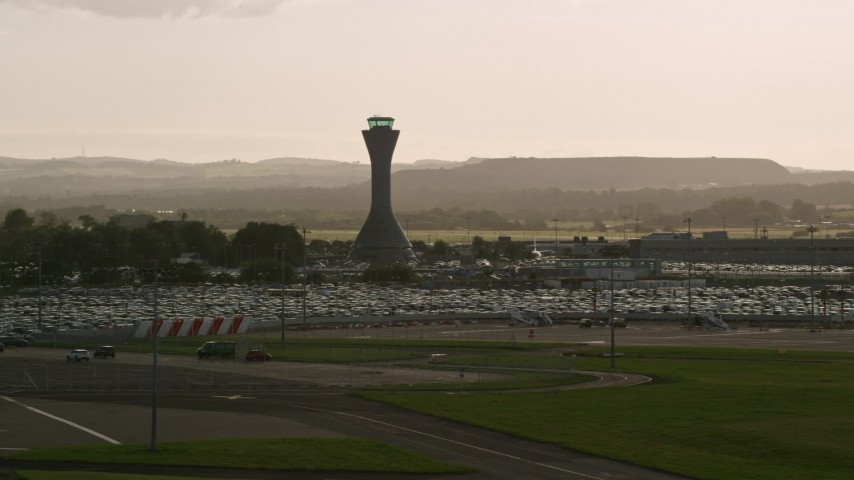6K stock footage aerial video of the control tower at Edinburgh Airport, Scotland Aerial Stock Footage | AX111_170