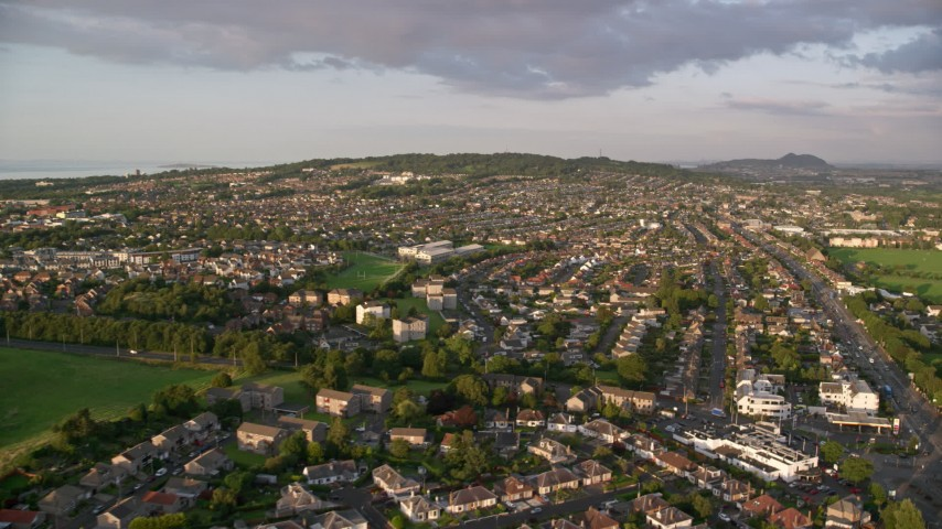 6K stock footage aerial video of residential neighborhoods in Edinburgh, Scotland at sunset Aerial Stock Footage | AX112_001