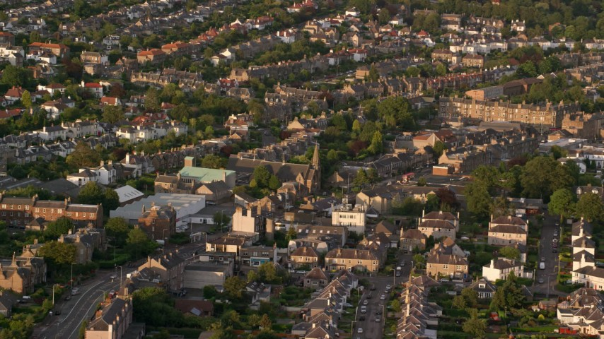 6K stock footage aerial video of Saint Ninian's Church among a neighborhood, Edinburgh, Scotland at sunset Aerial Stock Footage | AX112_002