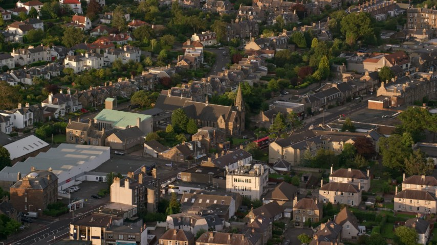 6K stock footage aerial video of Saint Ninian's Church and residential neighborhood, Edinburgh, Scotland at sunset Aerial Stock Footage | AX112_003