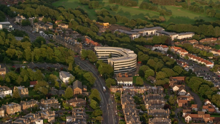 6K stock footage aerial video of office building, Edinburgh, Scotland at sunset Aerial Stock Footage | AX112_004