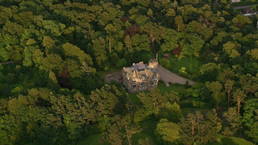 6K stock footage aerial video of orbiting Hillwood House and trees, Edinburgh, Scotland at sunset Aerial Stock Footage AX112_005 | Axiom Images