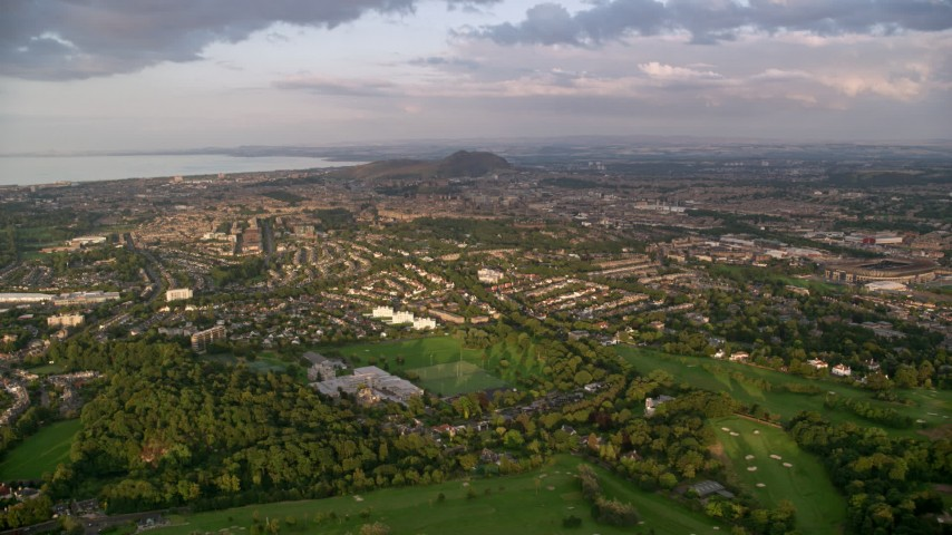 6K stock footage aerial video approach neighborhoods, Edinburgh, Scotland at sunset Aerial Stock Footage | AX112_006