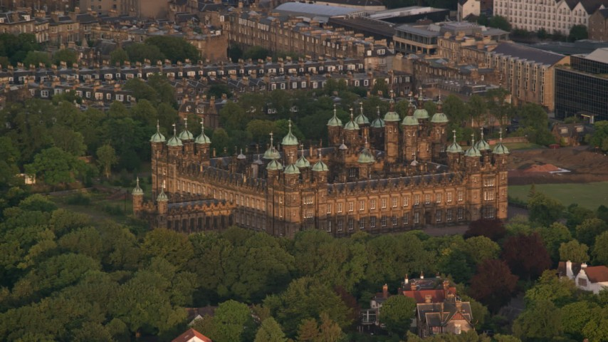 6K stock footage aerial video of castle with trees, Edinburgh, Scotland at sunset Aerial Stock Footage | AX112_008