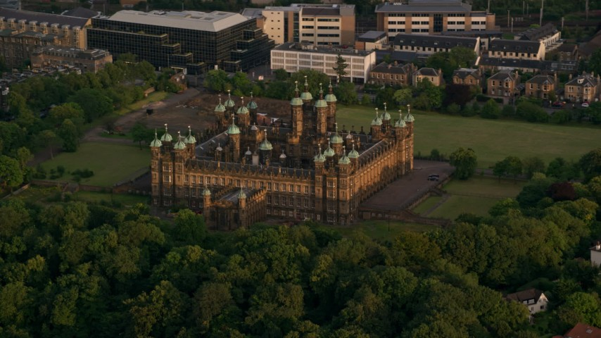 6K stock footage aerial video of orbiting a castle and trees, Edinburgh, Scotland at sunset Aerial Stock Footage | AX112_009