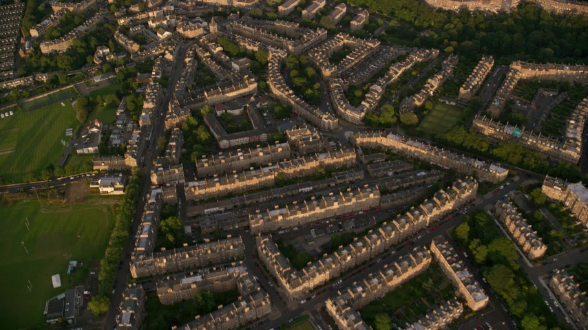 6K stock footage aerial video of flying over row houses, Edinburgh, Scotland at sunset Aerial Stock Footage | AX112_010