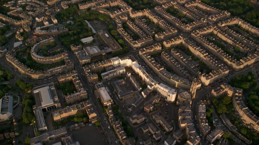 6K stock footage aerial video of row houses in Edinburgh, Scotland at sunset Aerial Stock Footage AX112_012 | Axiom Images