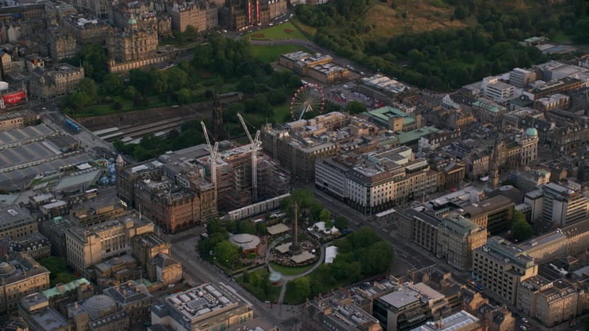 6K stock footage aerial video of construction cranes by St Andrew Square, Edinburgh, Scotland at sunset Aerial Stock Footage | AX112_014