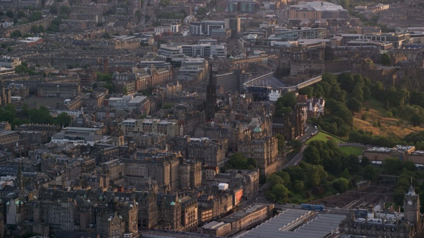 6K stock footage aerial video of The Hub and Edinburgh Castle, Scotland at sunset Aerial Stock Footage | AX112_016