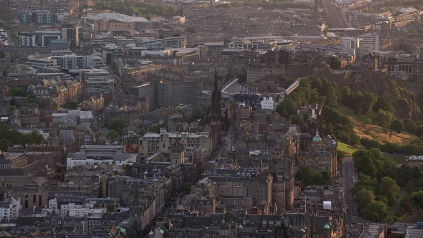 6K stock footage aerial video pan across The Hub and Edinburgh Castle, Scotland at sunset Aerial Stock Footage | AX112_018