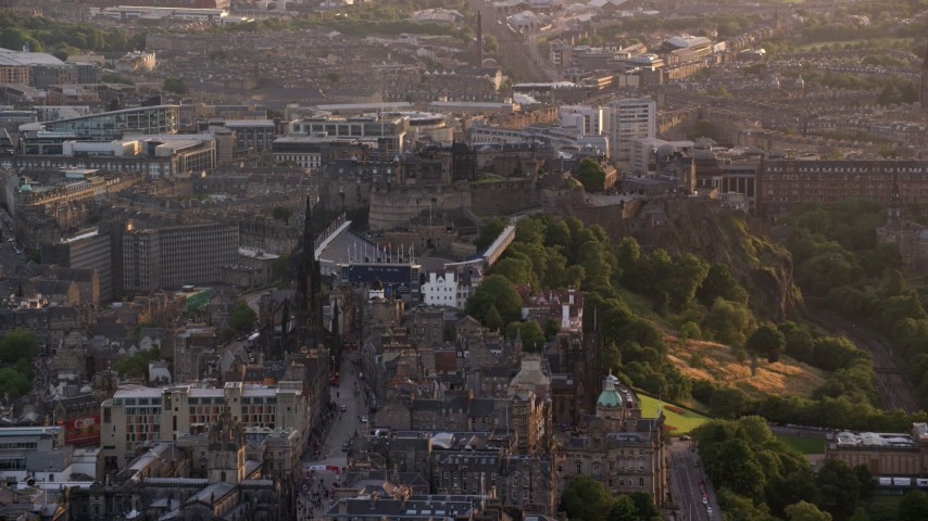 6K stock footage aerial video of passing by The Hub and Edinburgh Castle, Scotland at sunset Aerial Stock Footage | AX112_019