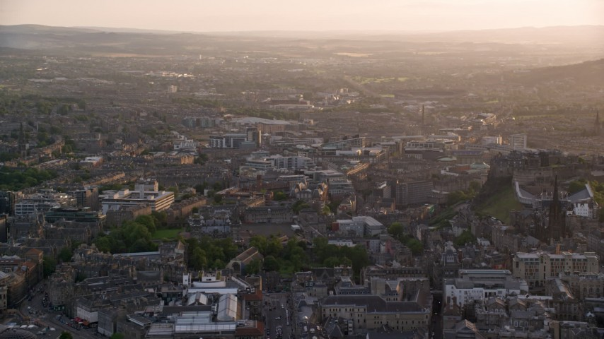 6K stock footage aerial video of a view of the cityscape of Edinburgh, Scotland at sunset Aerial Stock Footage | AX112_023