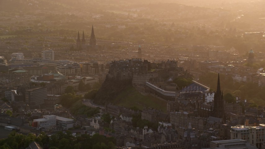 6K stock footage aerial video of a view of Edinburgh Castle, Scotland at sunset Aerial Stock Footage | AX112_024