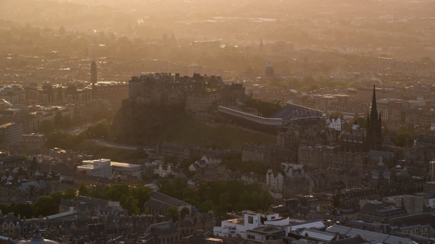 6K stock footage aerial video of the side of Edinburgh Castle, Scotland at sunset Aerial Stock Footage | AX112_025